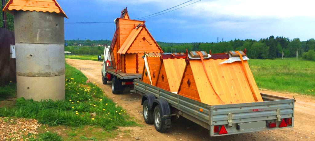 Доставка колодезных домиков
